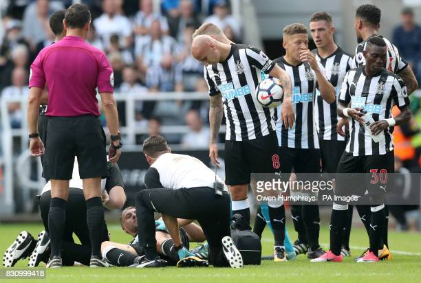 Newcastle United's Florian Lejeune received medical attention on the pitch during the Premier League match at St James' Park Newcastle