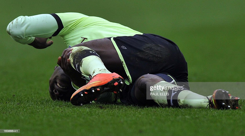 """Newcastle United's French defender Massadio Haidara is injured after a tackle by Wigan Athletic's English striker Callum McManaman during the English Premier League football match between Wigan Athletic and Newcastle United at The DW Stadium in Wigan, north-west England, on March 17, 2013. Haidara was stretchered off the pitch after the challenge that was unseen by referee Mark Halsey. USE. No use with unauthorized audio, video, data, fixture lists, club/league logos or """"live"""" services. Online in-match use limited to 45 images, no video emulation. No use in betting, games or single club/league/player publications"""