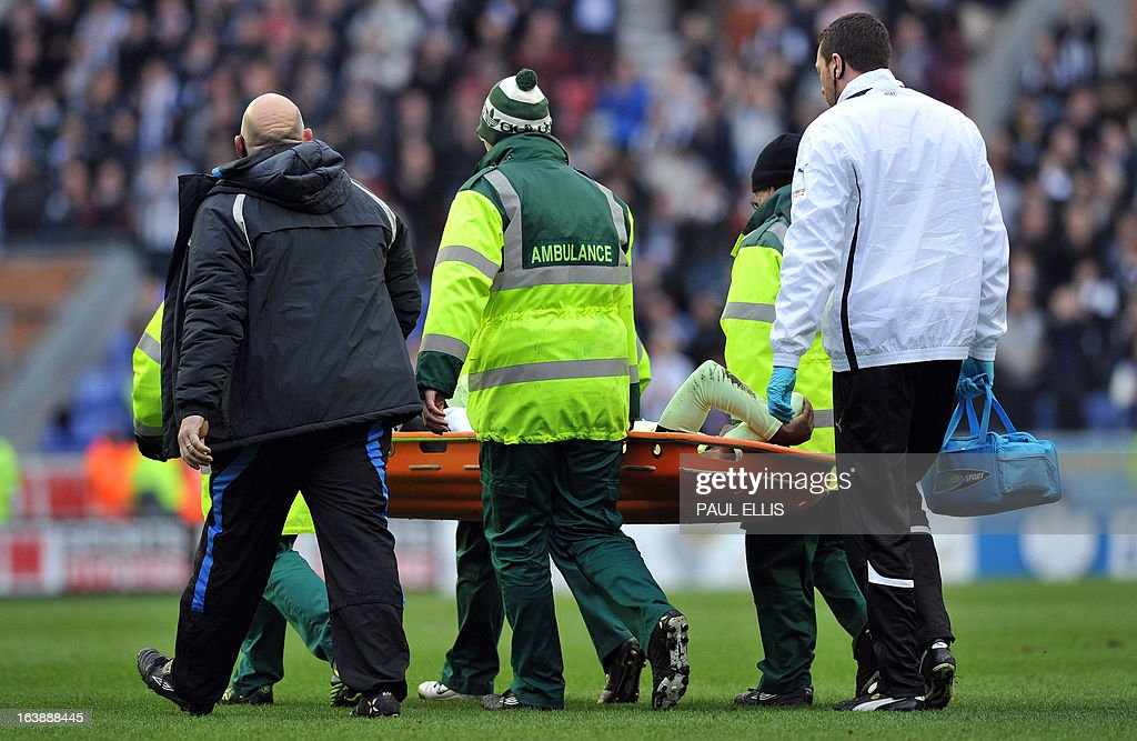 "Newcastle United's French defender Massadio Haidara is stretchered off the pitch after being injured in a tackle by Wigan Athletic's English striker Callum McManaman during the English Premier League football match between Wigan Athletic and Newcastle United at The DW Stadium in Wigan, north-west England, on March 17, 2013. Haidara was stretchered off the pitch after the challenge that was unseen by referee Mark Halsey. USE. No use with unauthorized audio, video, data, fixture lists, club/league logos or ""live"" services. Online in-match use limited to 45 images, no video emulation. No use in betting, games or single club/league/player publications"