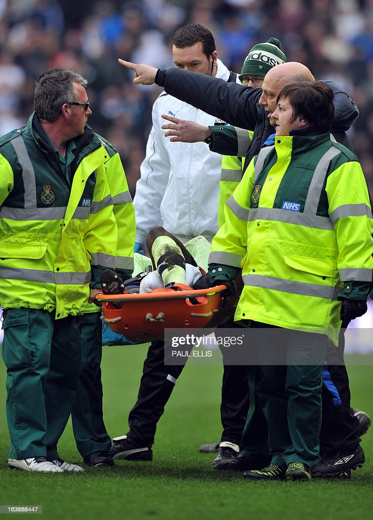 """Newcastle United's French defender Massadio Haidara is stretchered off the pitch after being injured in a tackle by Wigan Athletic's English striker Callum McManaman during the English Premier League football match between Wigan Athletic and Newcastle United at The DW Stadium in Wigan, north-west England, on March 17, 2013. Haidara was stretchered off the pitch after the challenge that was unseen by referee Mark Halsey. USE. No use with unauthorized audio, video, data, fixture lists, club/league logos or """"live"""" services. Online in-match use limited to 45 images, no video emulation. No use in betting, games or single club/league/player publications"""