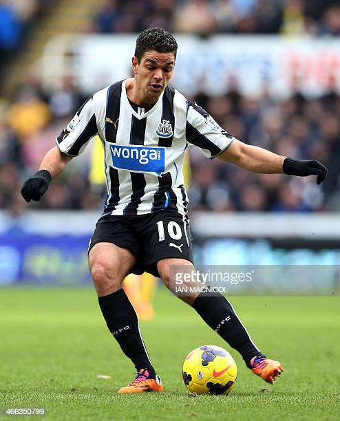 Newcastle United's French midfielder Hatem Ben Arfa controls the ball during the English Premier League football match between Newcastle United and...