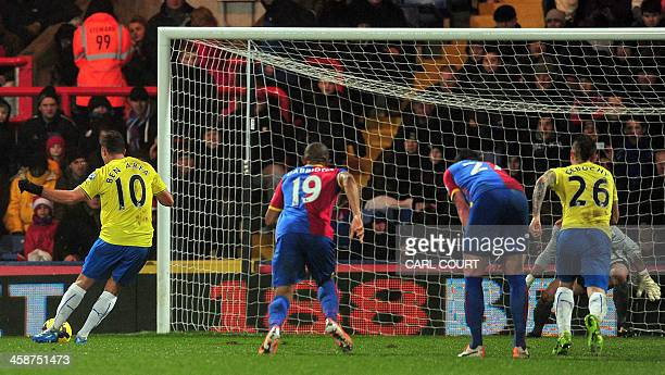 Newcastle United's French midfielder Hatem Ben Arfa scores from a penalty during the English Premier League football match between Crystal Palace and...