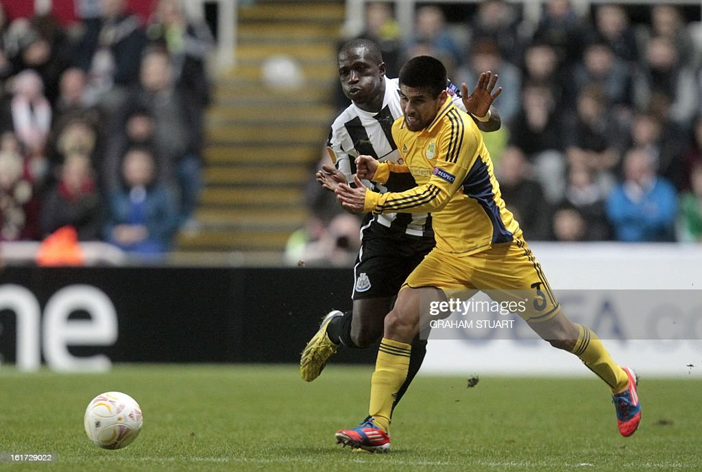 Newcastle United's French midfielder, Moussa Sissoko (L) vies with Metalist Kharkiv's Argentinian defender, Cristian Villagra (R) during the UEFA Europa League round of 32, first leg football match between Metalist Kharkiv and Newcastle United at St James Park, Newcastle-upon-Tyne, England, on February 14, 2013. The match ended in a goalless draw.