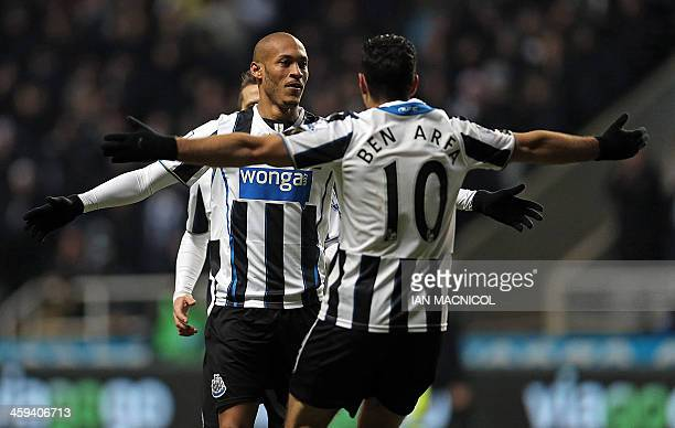 Newcastle United's French striker Yoan Gouffran celebrates scoring their second goal with Newcastle United's French midfielder Hatem Ben Arfa during...