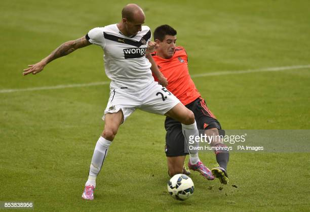 Newcastle United's Gabriel Obertan and Real Sociedad's Yuri Berchiche during the PreSeason friendly match at St James' Park Newcastle