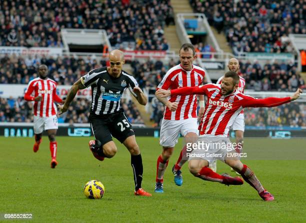 Newcastle United's Gabriel Obertan is tackled by Stoke City's Phil Bardsley