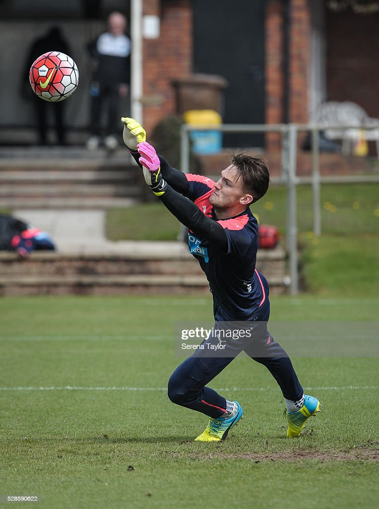 Newcastle United's Goalkeeper Freddie Woodman dives to deflect the ball during the Newcastle United Training session at The Newcastle United Training Centre on May 6, 2016, in Newcastle upon Tyne, England.