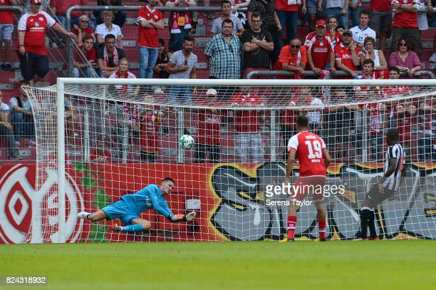 Newcastle United's Goalkeeper Freddie Woodman dives to make a save during the Pre Season Friendly match between FSV Mainz 05 and Newcastle United at...