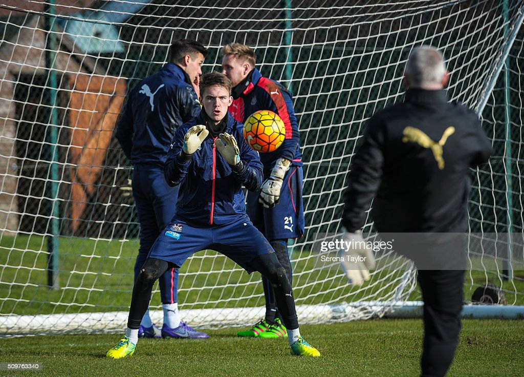 Newcastle United's Goalkeeper Freddie Woodman (C) prepares himself to save the ball in a warm up session during the Newcastle United Training session at The Newcastle United Training Centre on February 12, 2016, in Newcastle upon Tyne, England.