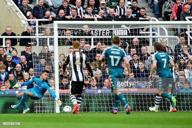 Newcastle United's Goalkeeper Karl Darlow dives for the ball during the Sky Bet Championship match between Newcastle United and Wigan Athletic at...