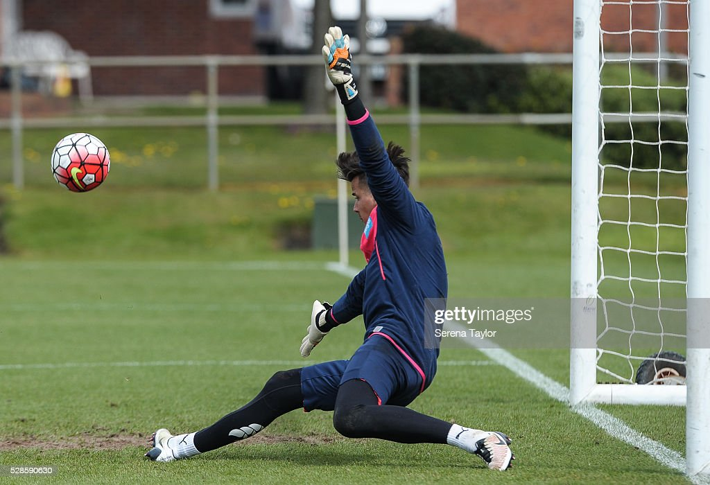 Newcastle United's Goalkeeper Karl Darlow dives to deflect the ball with his feet during the Newcastle United Training session at The Newcastle United Training Centre on May 6, 2016, in Newcastle upon Tyne, England.