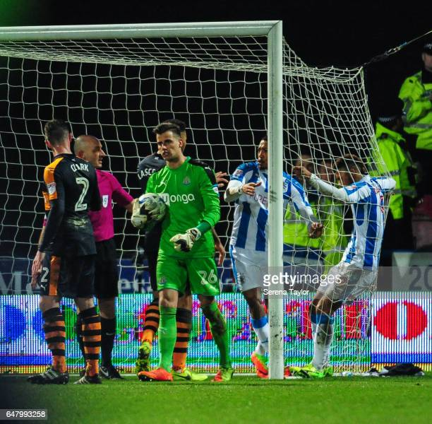 Newcastle United's Goalkeeper Karl Darlow holds on to the ball after Huddersfield score a penalty during the Sky Bet Championship Match between...