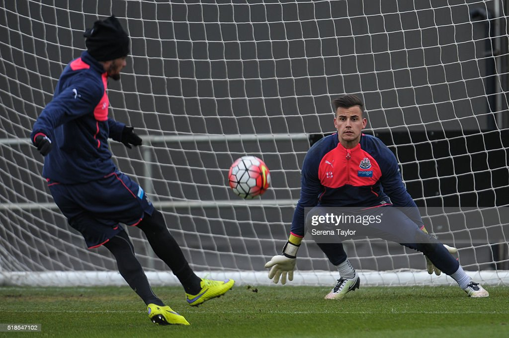 Newcastle United's Goalkeeper Karl Darlow (R) prepares to save the ball during the Newcastle United Training session at The Newcastle United Training Centre on April 1, 2016, in Newcastle upon Tyne, England.