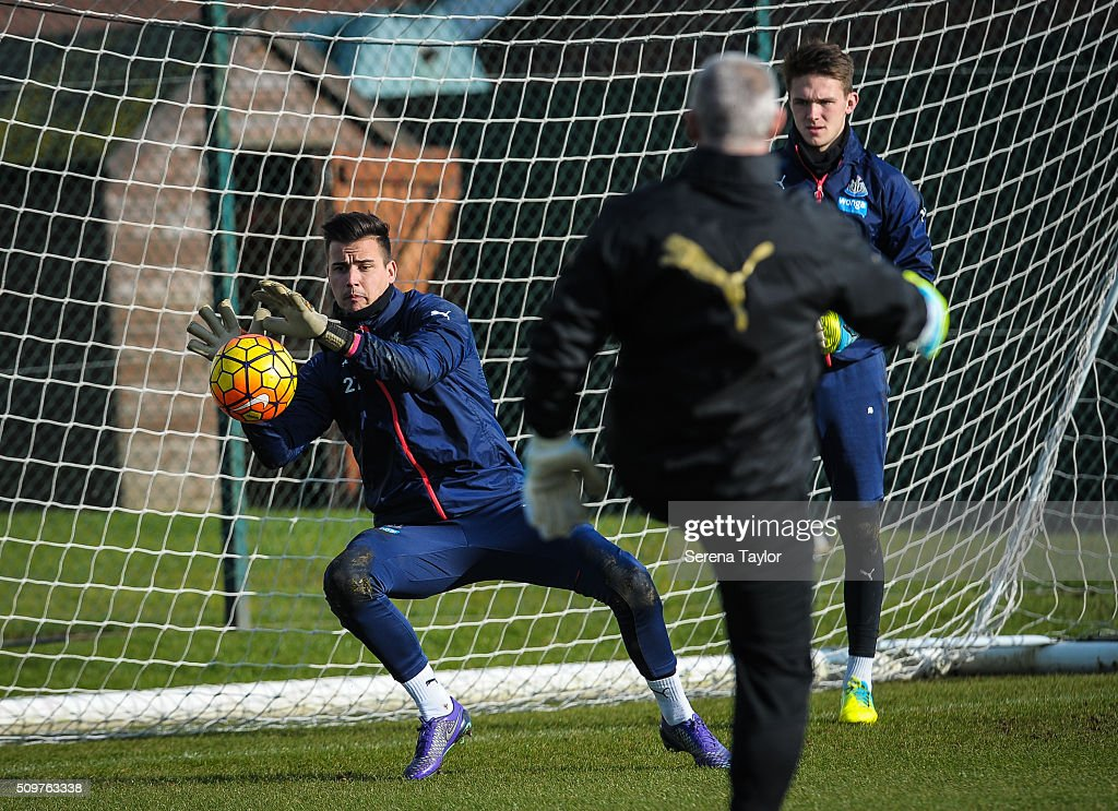 Newcastle United's Goalkeeper Karl Darlow (R) saves the ball in a warm up session during the Newcastle United Training session at The Newcastle United Training Centre on February 12, 2016, in Newcastle upon Tyne, England.