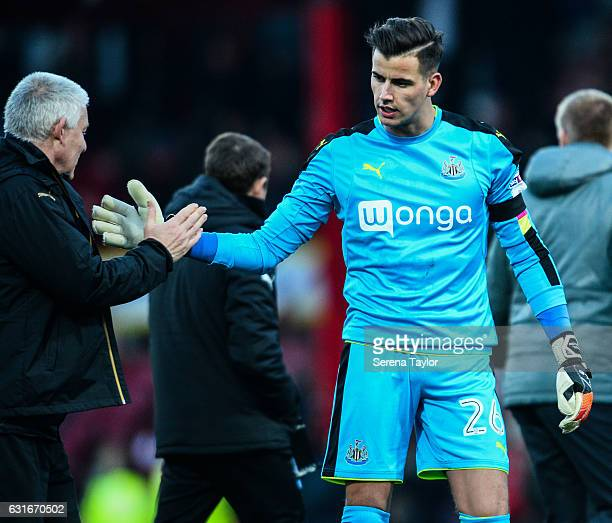 Newcastle United's Goalkeeper Karl Darlow slaps hands with Goalkeeping coach Simon Smith as he walks off the pitch at half time during the...