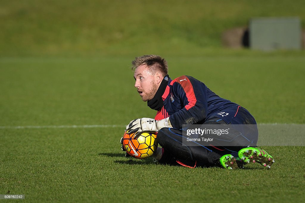 Newcastle United's Goalkeeper <a gi-track='captionPersonalityLinkClicked' href=/galleries/search?phrase=Rob+Elliot+-+Soccer+Goalkeeper&family=editorial&specificpeople=2833833 ng-click='$event.stopPropagation()'>Rob Elliot</a> sits on the grass with the ball in his hands during the Newcastle United Training session at The Newcastle United Training Centre on February 12, 2016, in Newcastle upon Tyne, England.