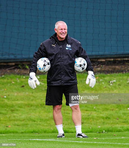Newcastle United's Goalkeeping Coach Simon Smith stands on the pitch with a ball under each arm during the Newcastle United training session at the...