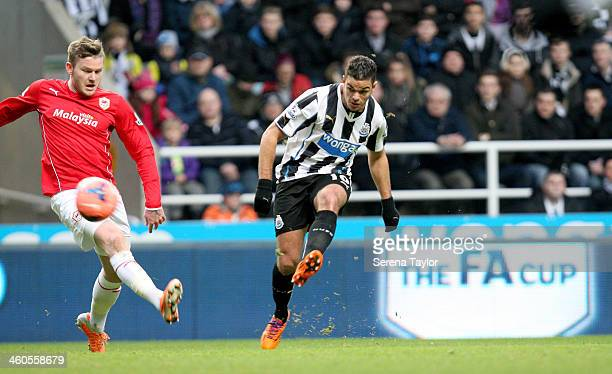 Newcastle United's Hatem Ben Arfa strikes the ball past Cardiff City's Aron Gunnarsson during the Budweiser FA Cup third round match between...