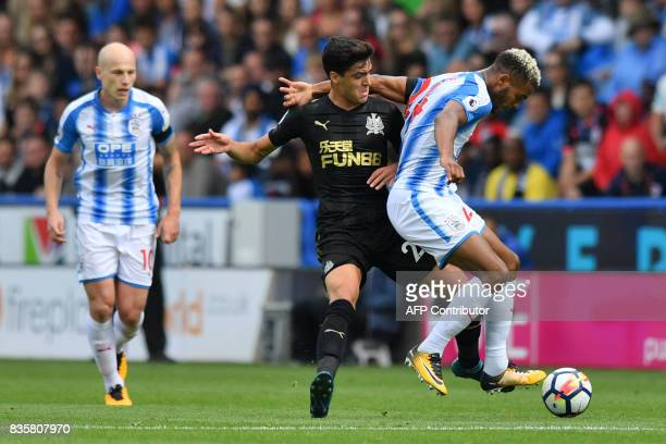 TOPSHOT Newcastle United's Irish defender Ciaran Clark vies with Huddersfield Town's Beninese striker Steve Mounie during the English Premier League...