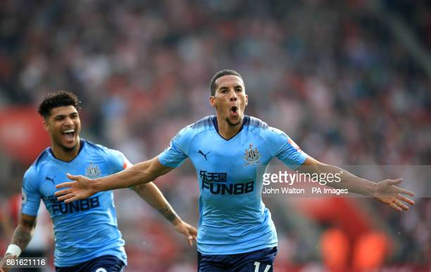 Newcastle United's Isaac Hayden celebrates scoring his side's first goal of the game with teammate DeAndre Yedlin during the Premier League match at...