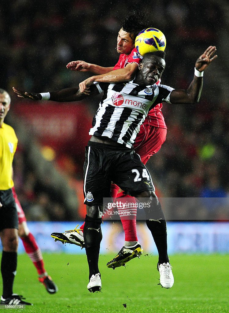 """Newcastle United's Ivorian midfielder Cheick Tiote (R) vies with Southampton's English midfielder Jack Cork (L) during their English Premier League football match at St. Mary's Stadium, Southampton, southern England, on November 25, 2012. Southampton won the match 2-0. USE. No use with unauthorized audio, video, data, fixture lists, club/league logos or """"live"""" services. Online in-match use limited to 45 images, no video emulation. No use in betting, games or single club/league/player publications."""