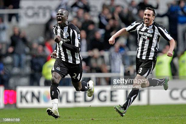 Newcastle United's Ivorian midfielder Cheik Tiote celebrates scoring their equalizing goal with Spanish defender Jose Enrique during the English...