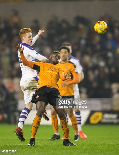 Newcastle United's Jack Colback challenges Wolverhampton Wanderers' Bright Enobakhare during the Sky Bet Championship match at Molineux Wolverhampton