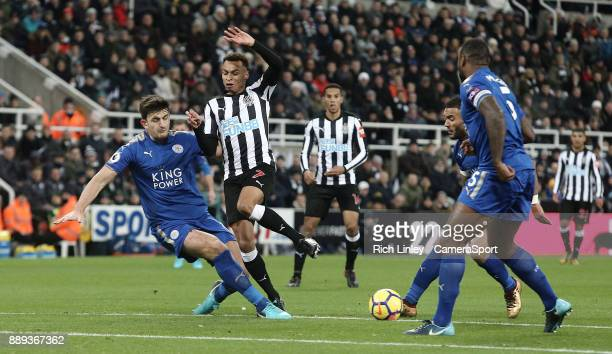 Newcastle United's Jacob Murphy is tackled by Leicester City's Harry Maguire during the Premier League match between Newcastle United and Leicester...