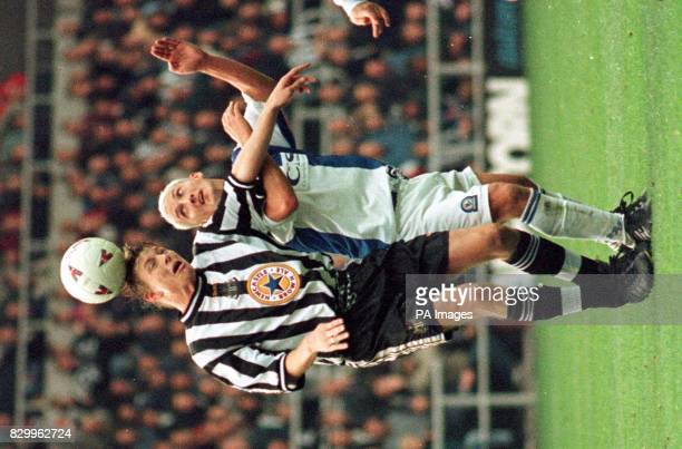 Newcastle United's John Beresford and Blackburn's Billy McKinlay tangle during today's 11 draw Photo by Paul Barker/PA