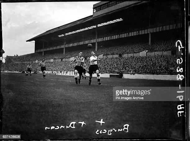 Newcastle United's John Duncan and Tottenham Hotspur's Ron Burgess chase a through ball