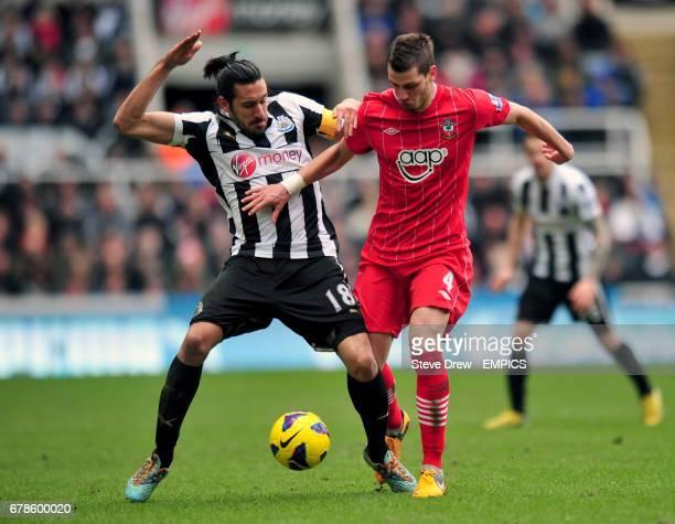 Newcastle United's Jonas Gutierrez and Southampton's Morgan Schneiderlin battle for the ball