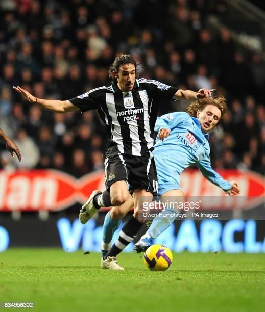 Newcastle United's Jonas Gutierrez and Tottenham Hotspur's Luka Modric battle for the ball