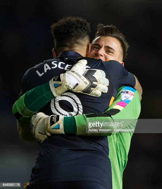 Newcastle United's Karl Darlow celebrates with Jamaal Lascelles after their 21 victory during the Sky Bet Championship match between Brighton Hove...