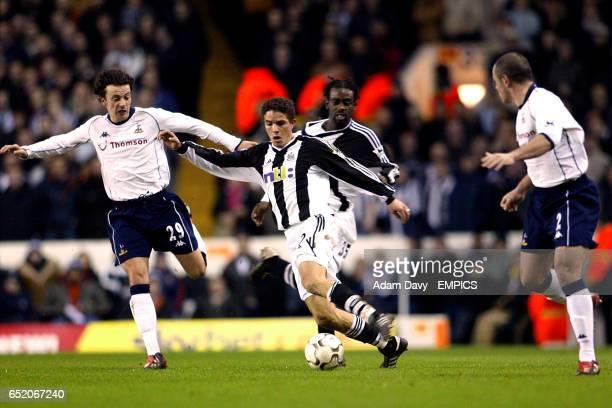 Newcastle United's Laurent Robert gets between Tottenham Hotspur's Simon Davies and Stephen Carr