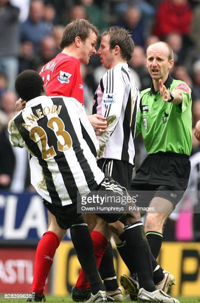 Newcastle United's Lee Bowyer and Liverpool's Dietmar Hamann square up to each other as referee Mike Riley tries to defuse the situation