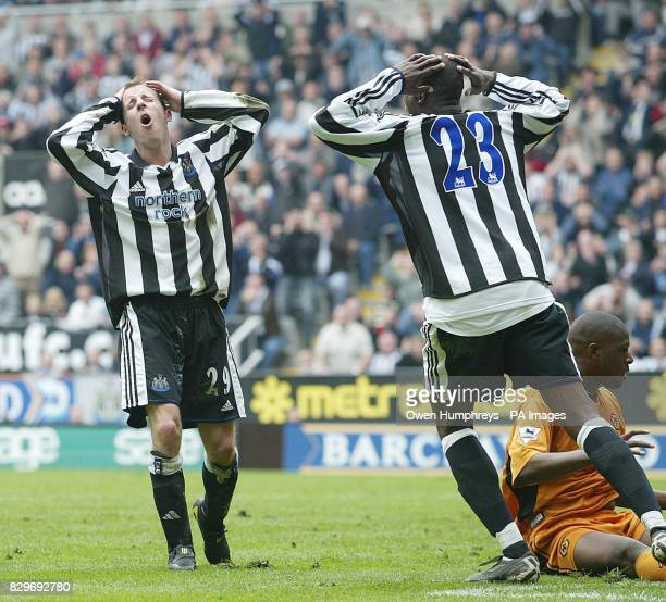 Newcastle United's Lee Bowyer and Shola Ameobie can't believe their luck after a near miss against Wolverhampton Wanderers during their Barclaycard...