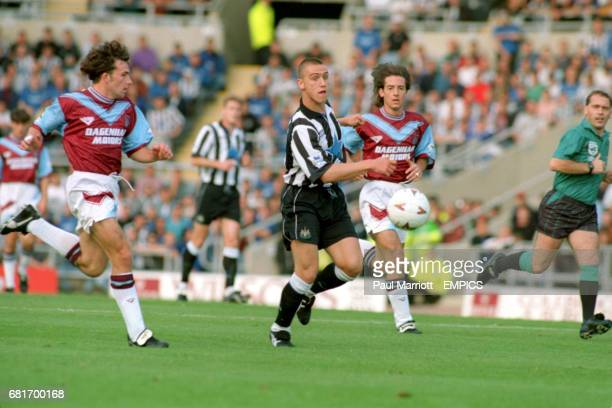 Newcastle United's Lee Clark plays the ball through watched by West Ham United's Matty Holmes and Ian Bishop