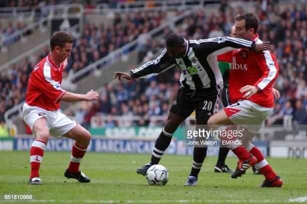 Newcastle United's Lomana LuaLua is tackled by a combination of Charlton Athletic's Mark Kinsella and Scott Parker