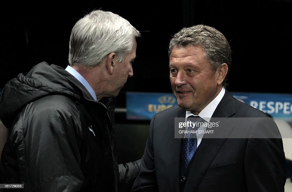 Newcastle United's manager, Alan Pardew (L) and Metalist Kharkiv's manager, Myron Markevich speak before the UEFA Europa League round of 32, first leg football match between Metalist Kharkiv and Newcastle United at St James Park, Newcastle-upon-Tyne, England, on February 14, 2013. The match ended in a goalless draw.