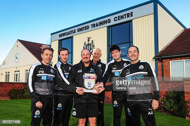 Newcastle United's Manager Rafael Benitez poses for a photograph with the Sky Bet Trophy and his senior coaching staff seen LR Assistant Manager...