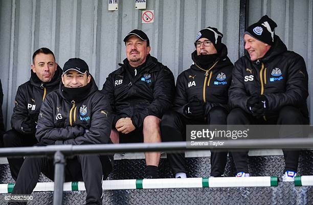 Newcastle United's Manager Rafael Benitez sits in the stands with coaching staff seen LR Francisco de Miguel Moreno Antonio Gomez Perez Mikel Antia...