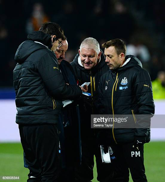 Newcastle United's Manager Rafael Benitez talks to his staff seen LR First Team Coach Mikel Antia Goalkeeping Coach Simon Smith and Assistant Manager...