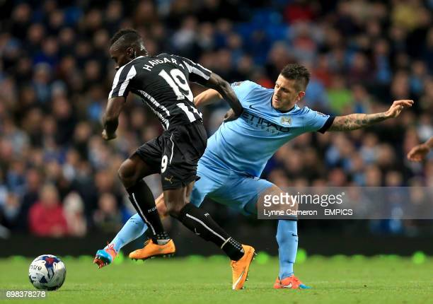 Newcastle United's Massadio Haidara and Manchester City's Stevan Jovetic battle for the ball
