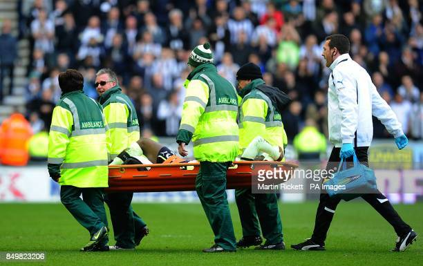 Newcastle United's Massadio Haidara is carried from the field on a stretcher after picking up an injury