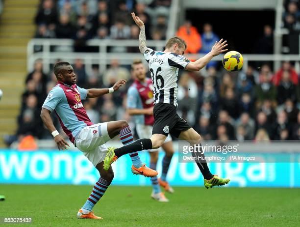 Newcastle United's Mathieu Debuchy and Aston Villa's Yacouba Sylla battle for the ball