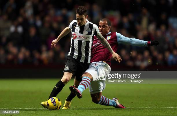 Newcastle United's Matieu Debuchy is tackled by Aston Villa's Gabriel Agbonlahor during the Barclays Premier League match at Villa Park Birmingham