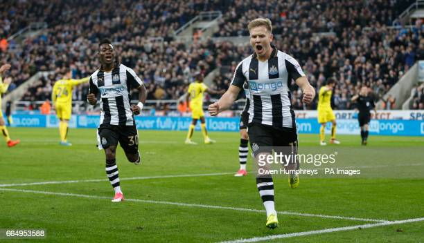 Newcastle United's Matt Richie celebrates scoring his side's first goal of the game from the penalty spot only for the referee Keith Stroud to...