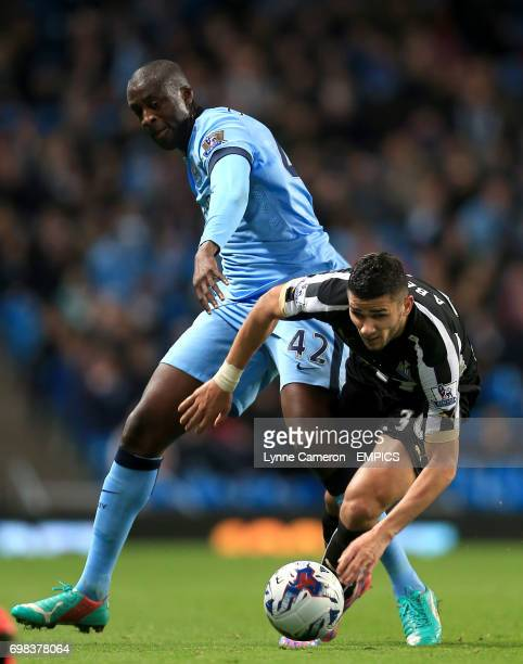 Newcastle United's Mehdi Abeid and Manchester City's Yaya Toure battle for the ball