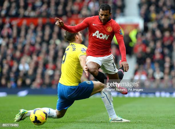 Newcastle United's Mike Williamson challenges Manchester United's Luis Nani