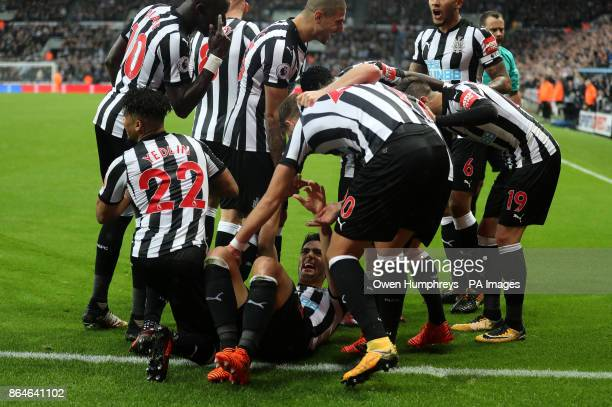 Newcastle United's Mikel Merino celebrates scoring his side's first goal of the game with teammates during the Premier League match at St James' Park...
